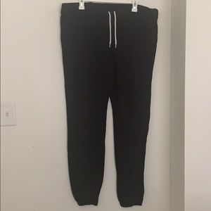A pair of black mossimo supply co. sweat pants.